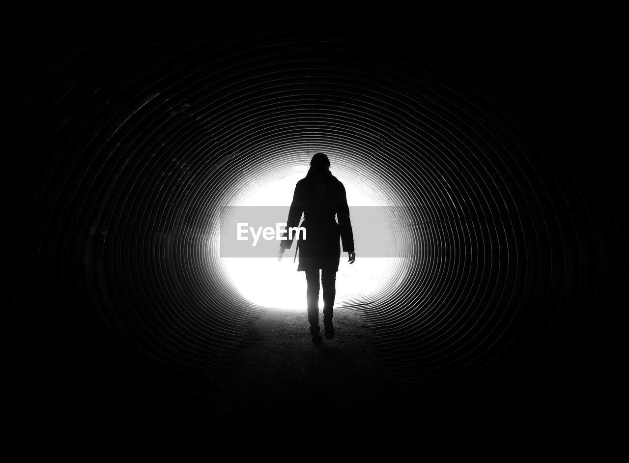 Full Length Rear View Of Woman Walking In Tunnel