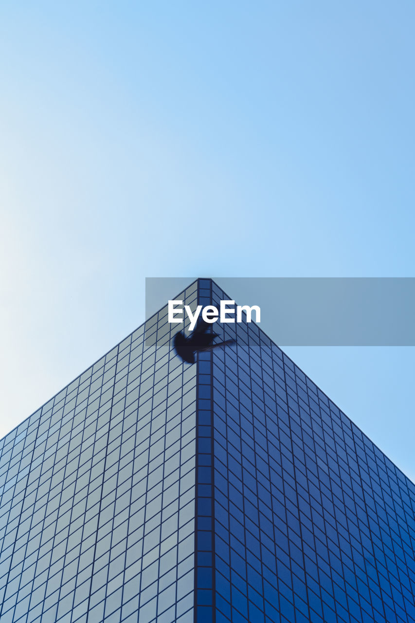 built structure, architecture, building exterior, sky, low angle view, building, clear sky, copy space, no people, nature, office building exterior, blue, city, day, tall - high, modern, outdoors, office, skyscraper, tower, directly below