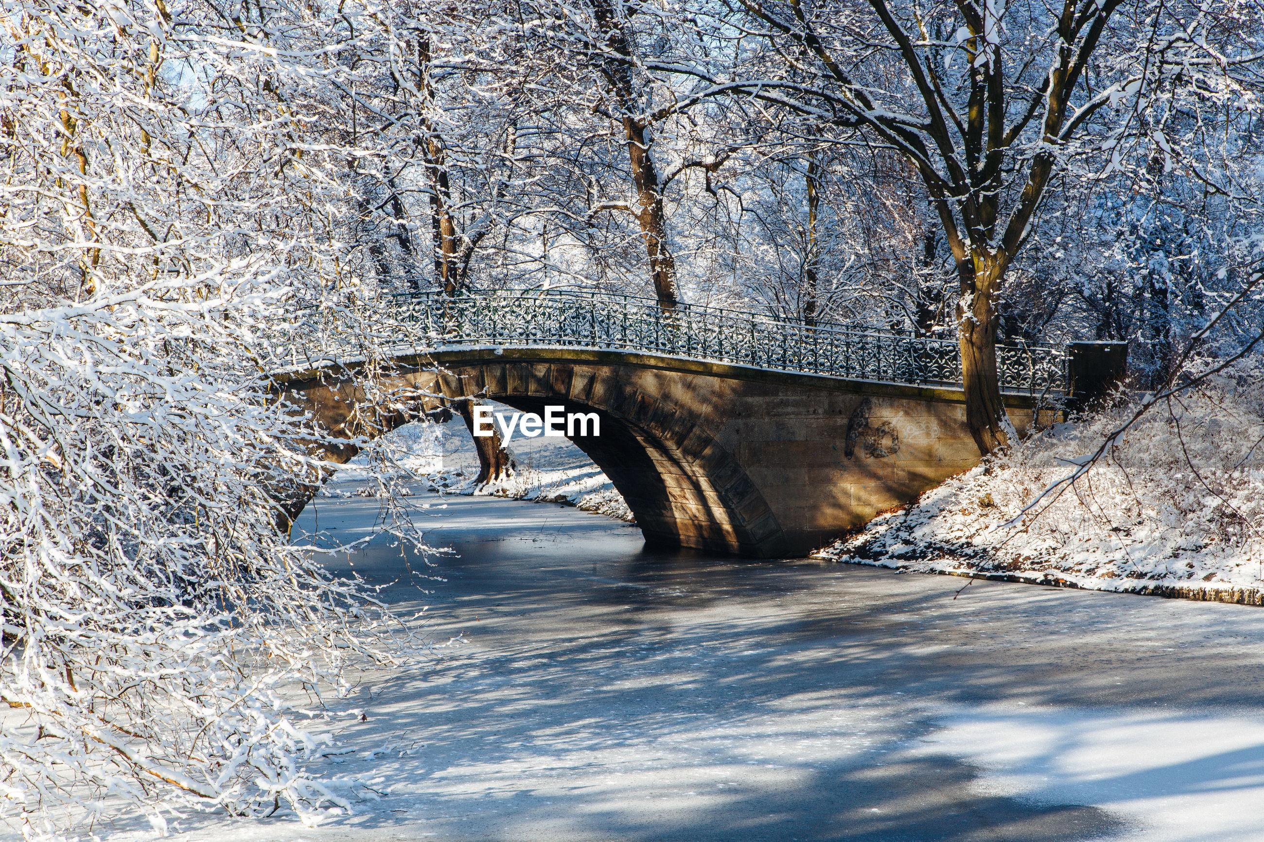 Bridge over frozen lake during winter