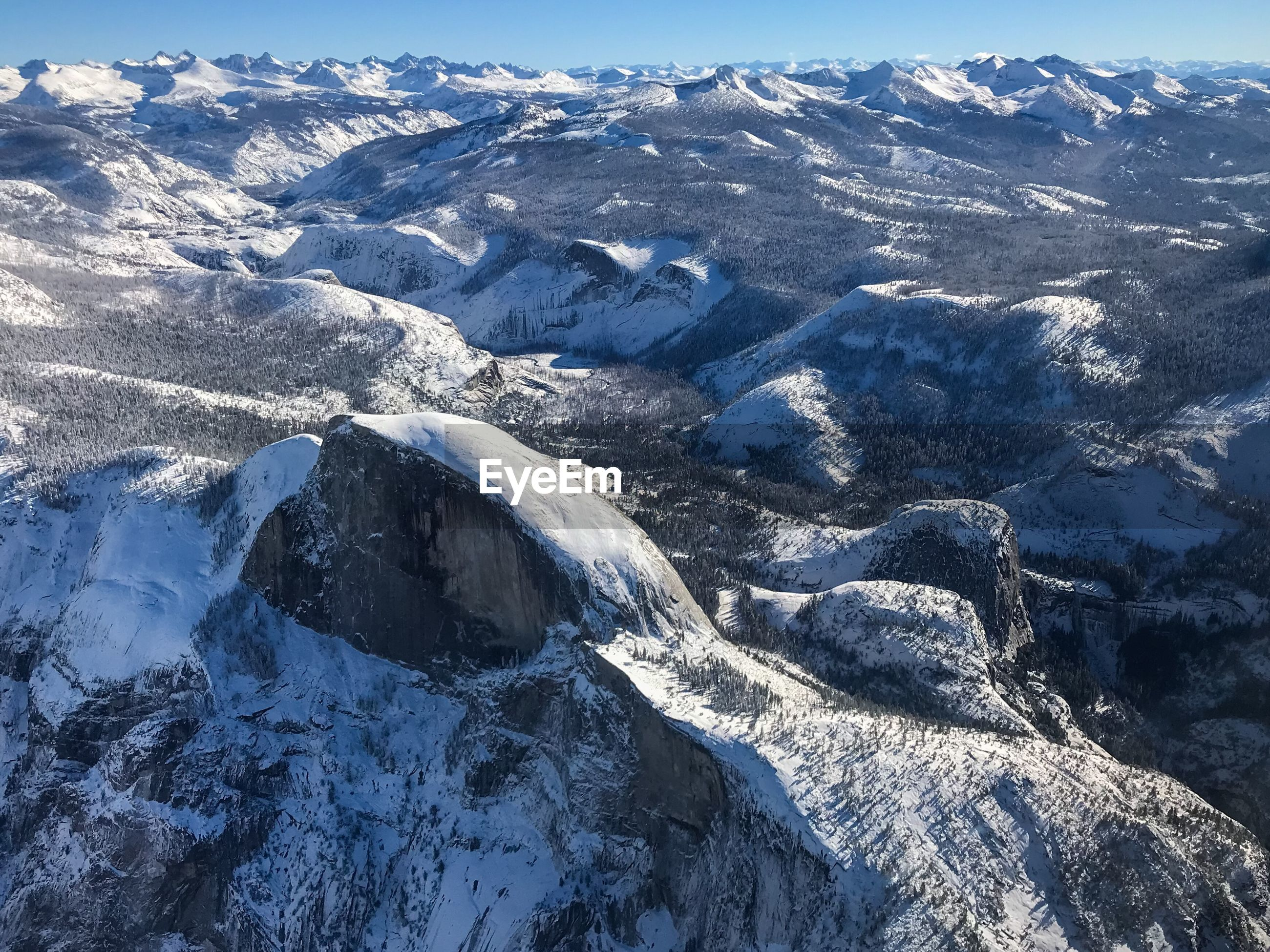 HIGH ANGLE VIEW OF SNOWCAPPED MOUNTAIN RANGE