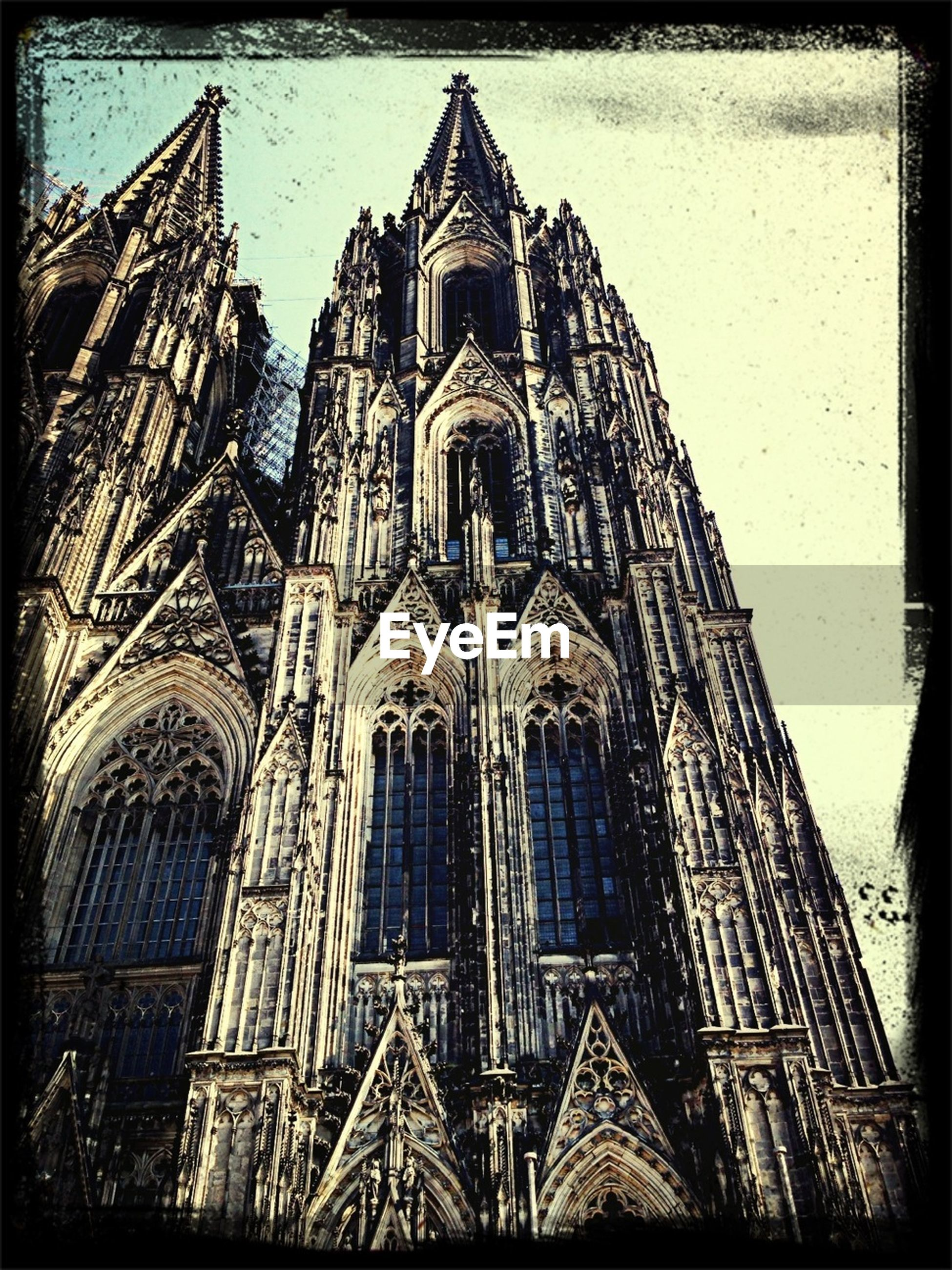 architecture, building exterior, built structure, place of worship, church, religion, spirituality, transfer print, low angle view, cathedral, auto post production filter, sky, window, facade, no people, cross, outdoors, tower