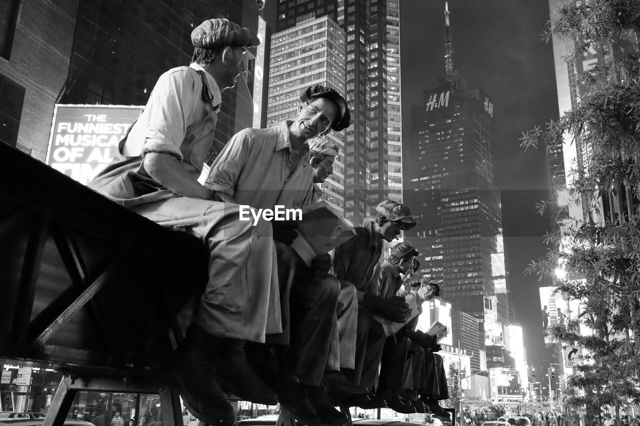 LOW ANGLE VIEW OF PEOPLE IN CITY
