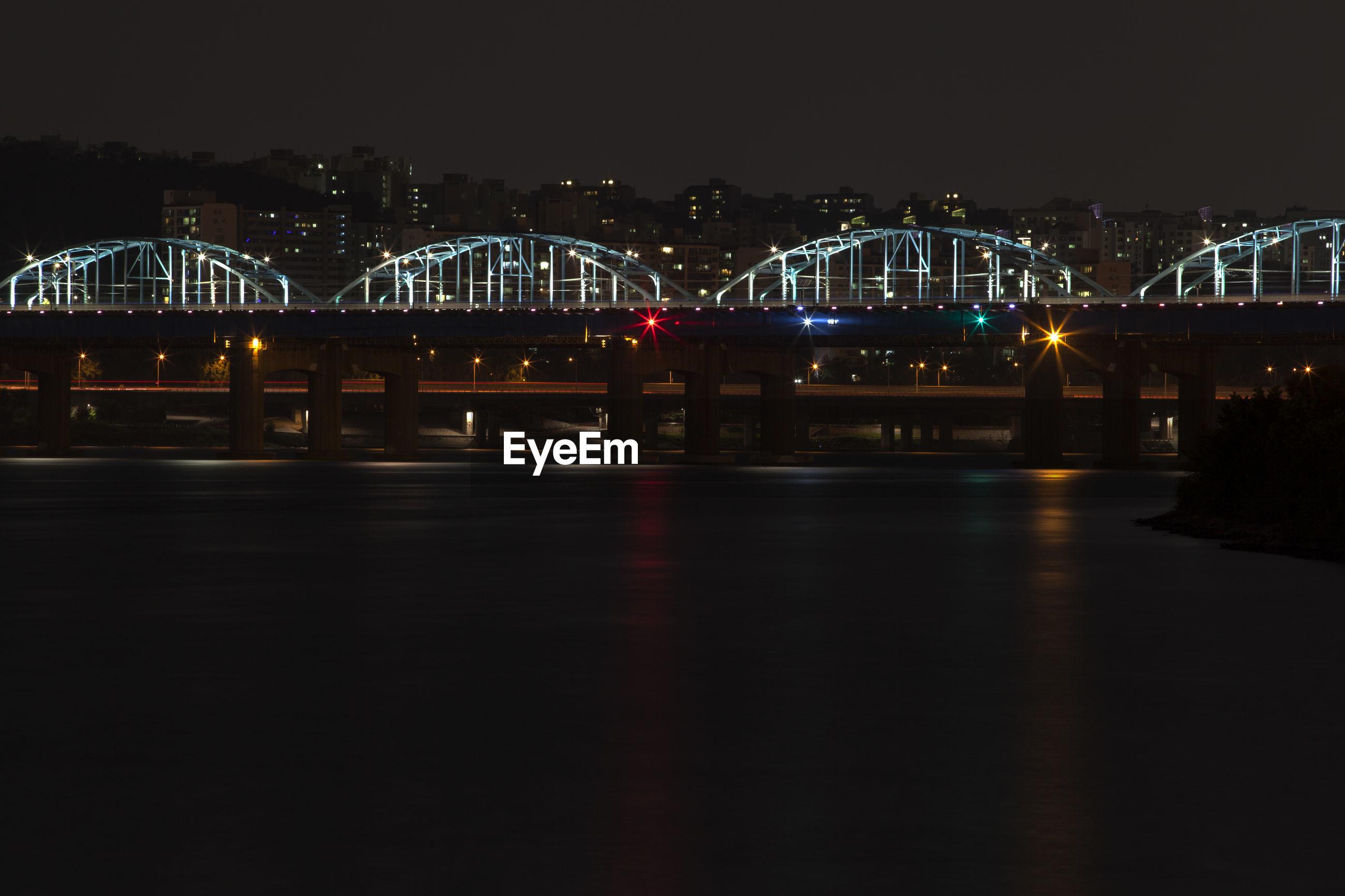Dongjakdaegyo bridge over han river against sky in city at night
