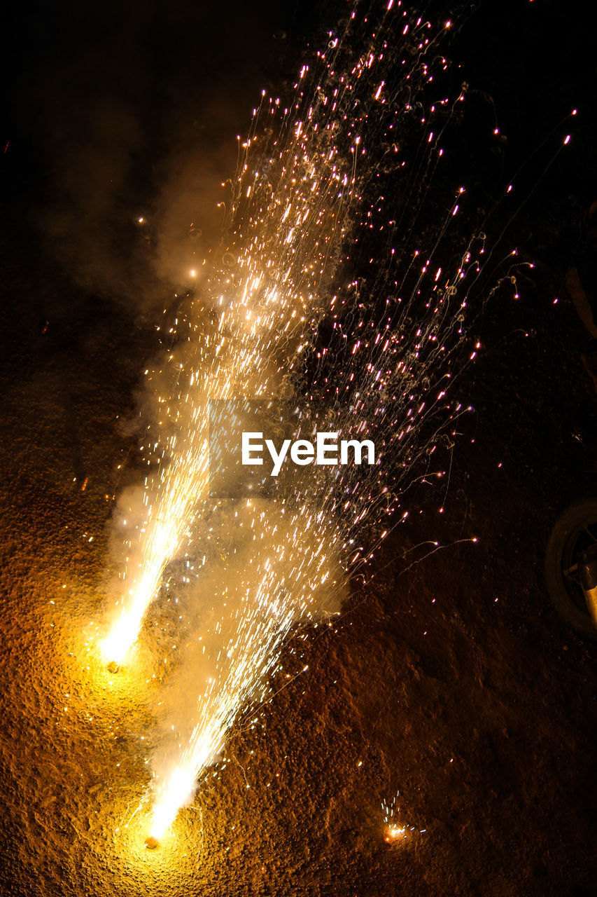 night, exploding, long exposure, sparks, motion, firework display, firework - man made object, glowing, illuminated, no people, celebration, blurred motion, arts culture and entertainment, low angle view, outdoors, firework, sky