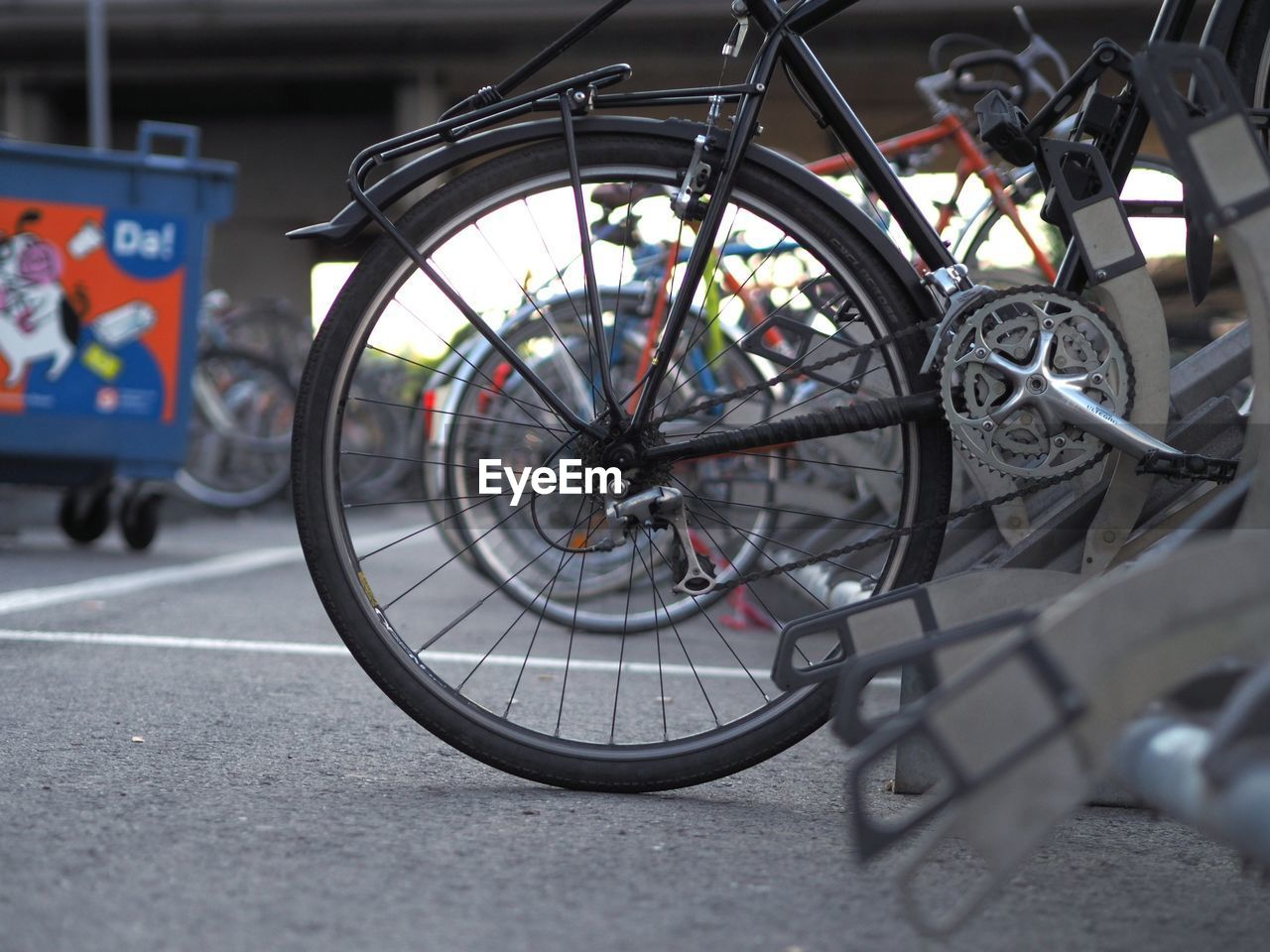 CLOSE-UP OF BICYCLE PARKED ON ROAD