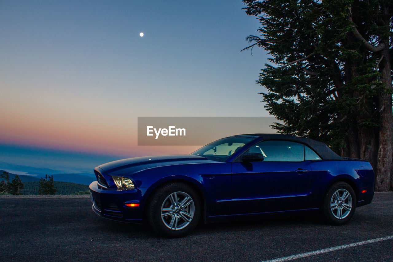car, blue, transportation, moon, no people, sky, clear sky, tree, outdoors, day