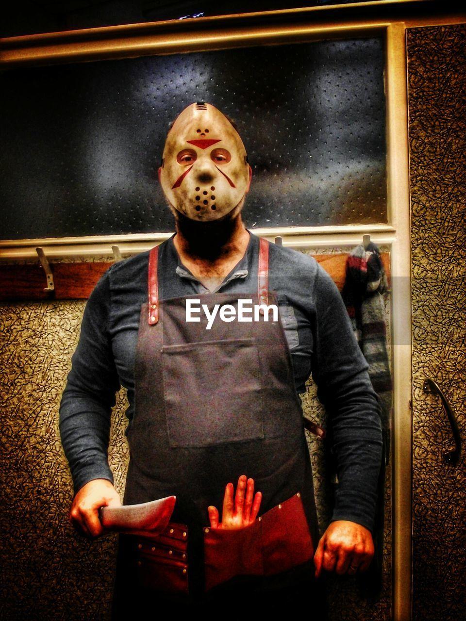 Portrait of butcher holding knife