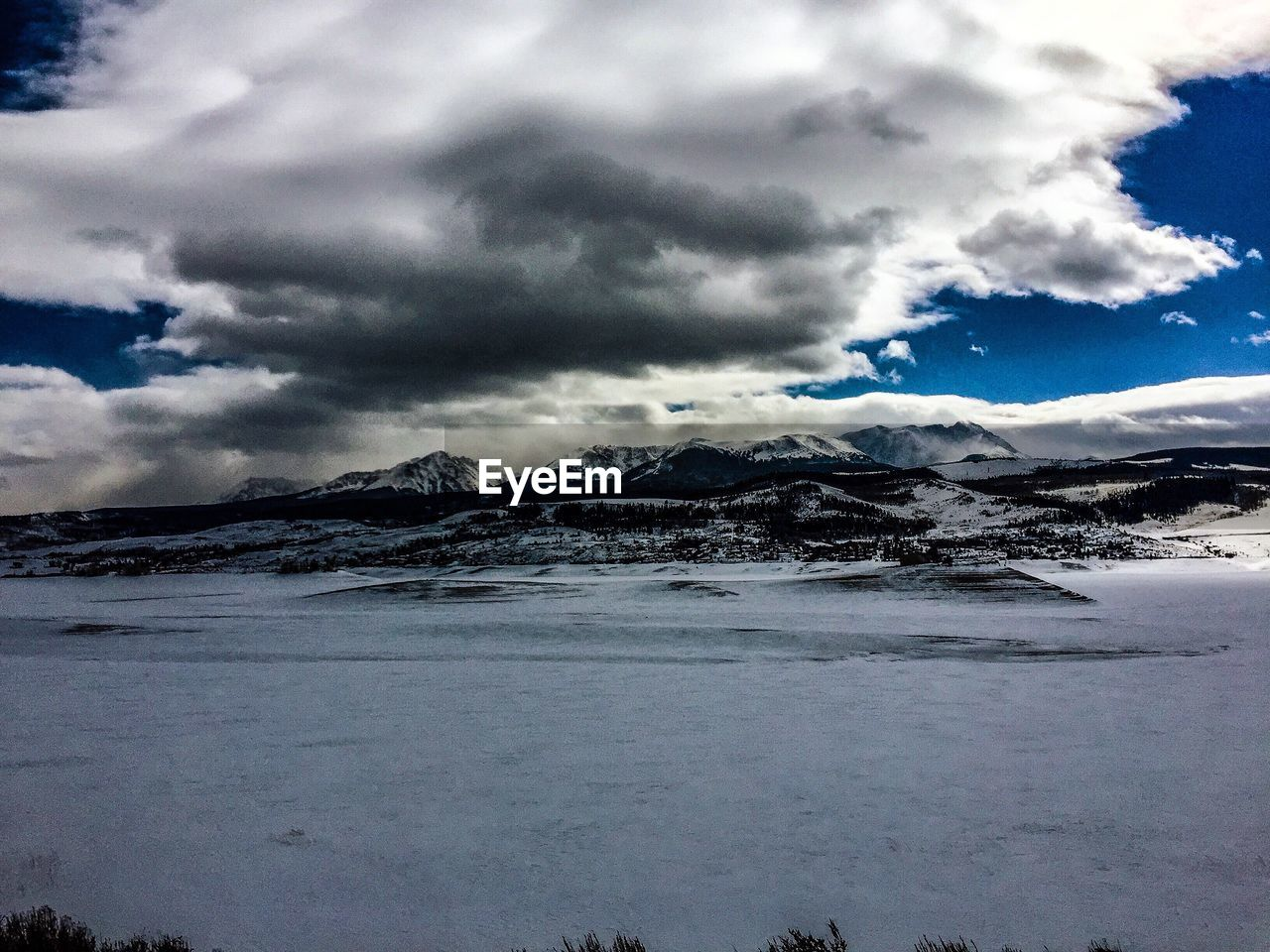 cloud - sky, sky, beauty in nature, scenics - nature, mountain, tranquil scene, cold temperature, snow, winter, environment, tranquility, day, no people, nature, landscape, non-urban scene, snowcapped mountain, outdoors, mountain range
