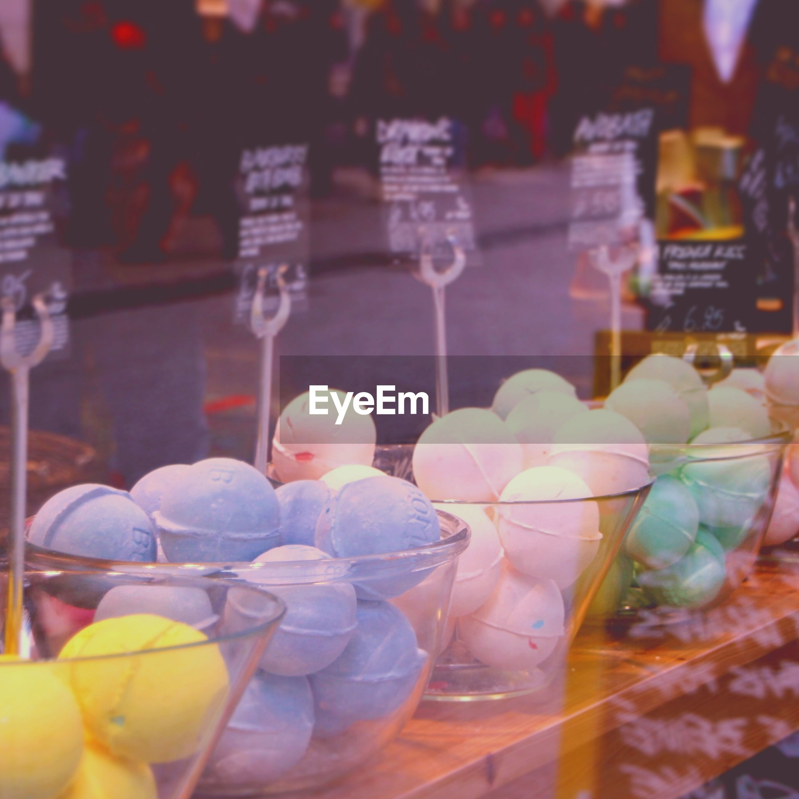 large group of objects, multi colored, variation, abundance, still life, choice, freshness, for sale, food and drink, indoors, close-up, arrangement, focus on foreground, colorful, in a row, retail, selective focus, glass - material, market stall, collection