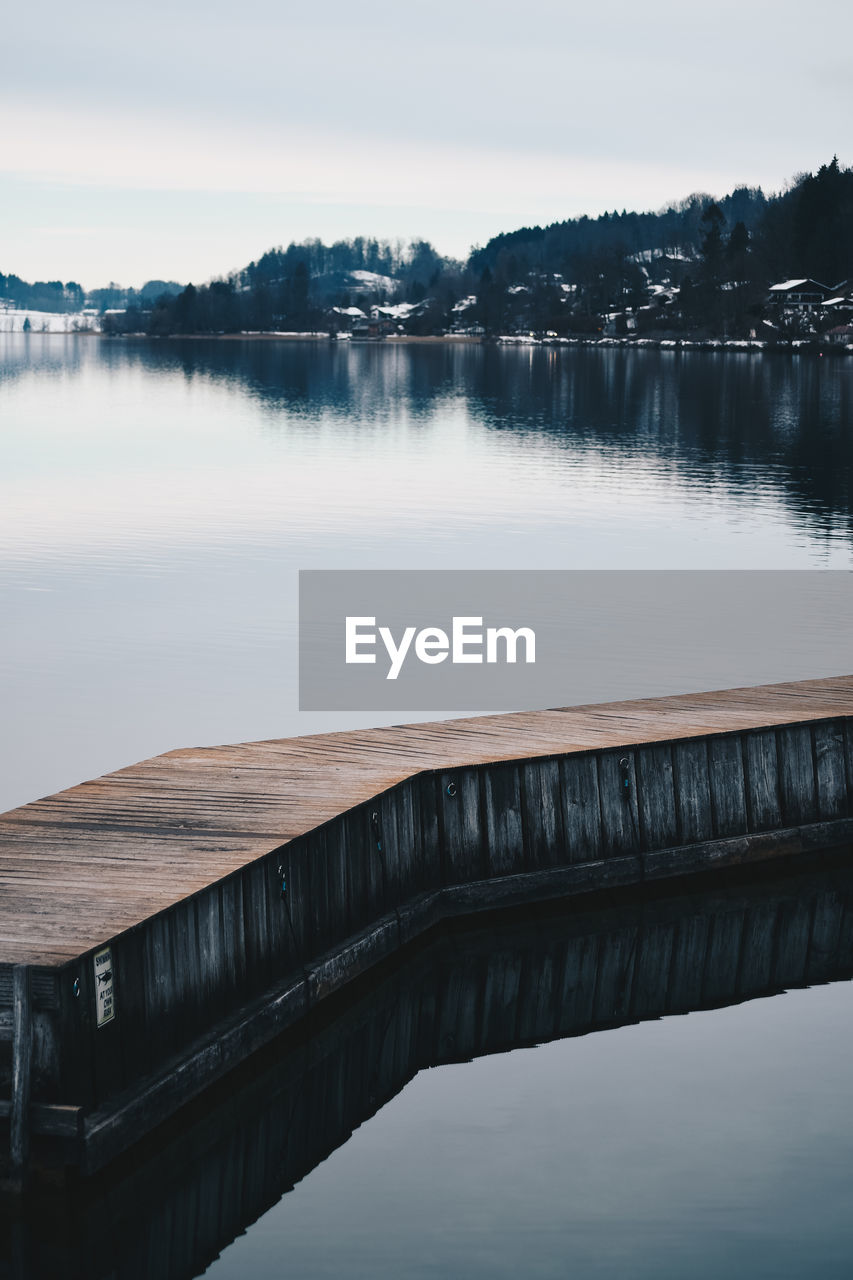 water, lake, sky, no people, nature, wood - material, bridge, scenics - nature, tranquility, reflection, tranquil scene, built structure, architecture, connection, bridge - man made structure, beauty in nature, day, non-urban scene, outdoors, long