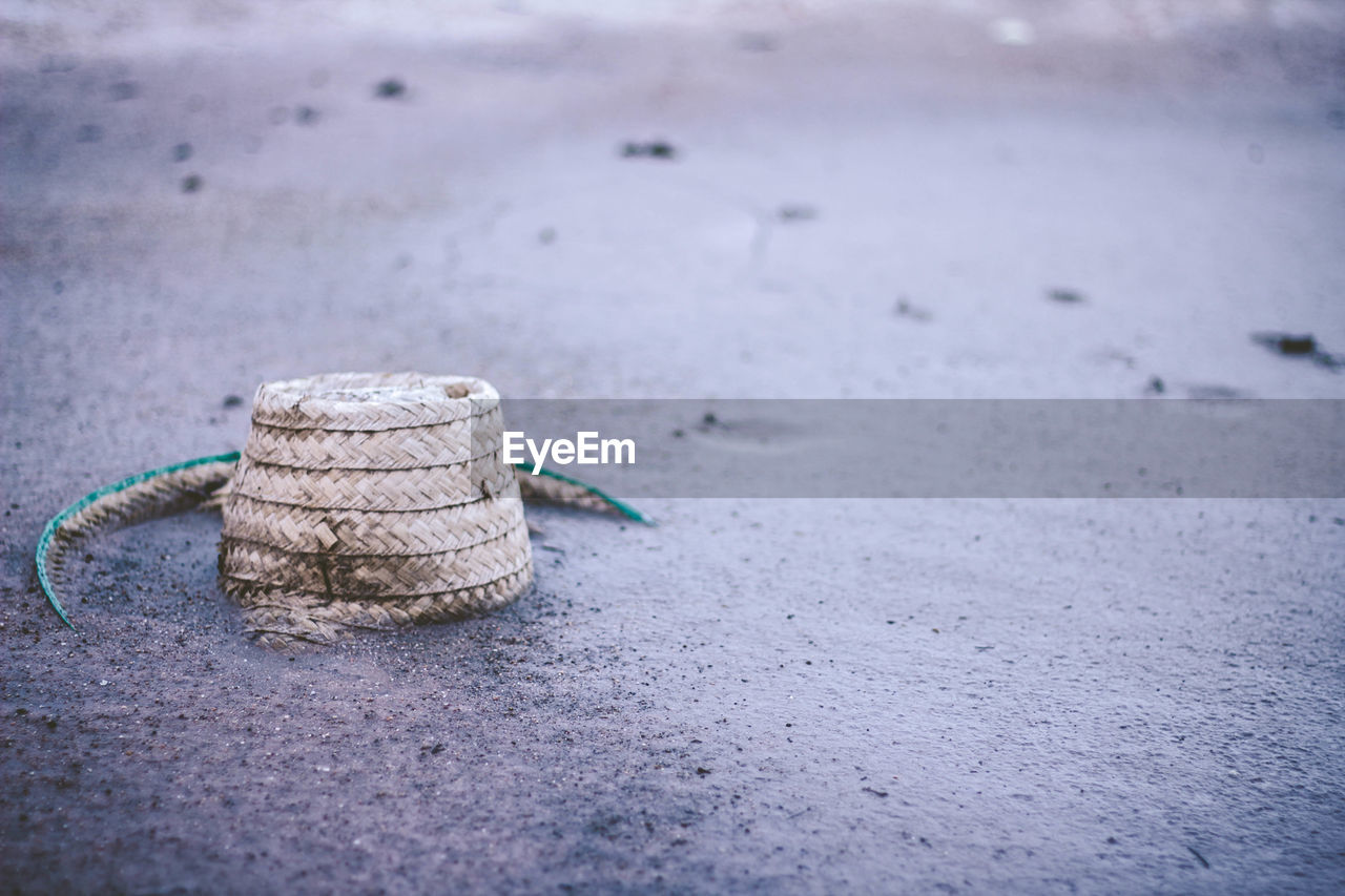 day, land, no people, sand, close-up, beach, nature, selective focus, focus on foreground, water, outdoors, tranquility, rope, pattern, tied up, stack, single object, beauty in nature, winter, sea, surface level