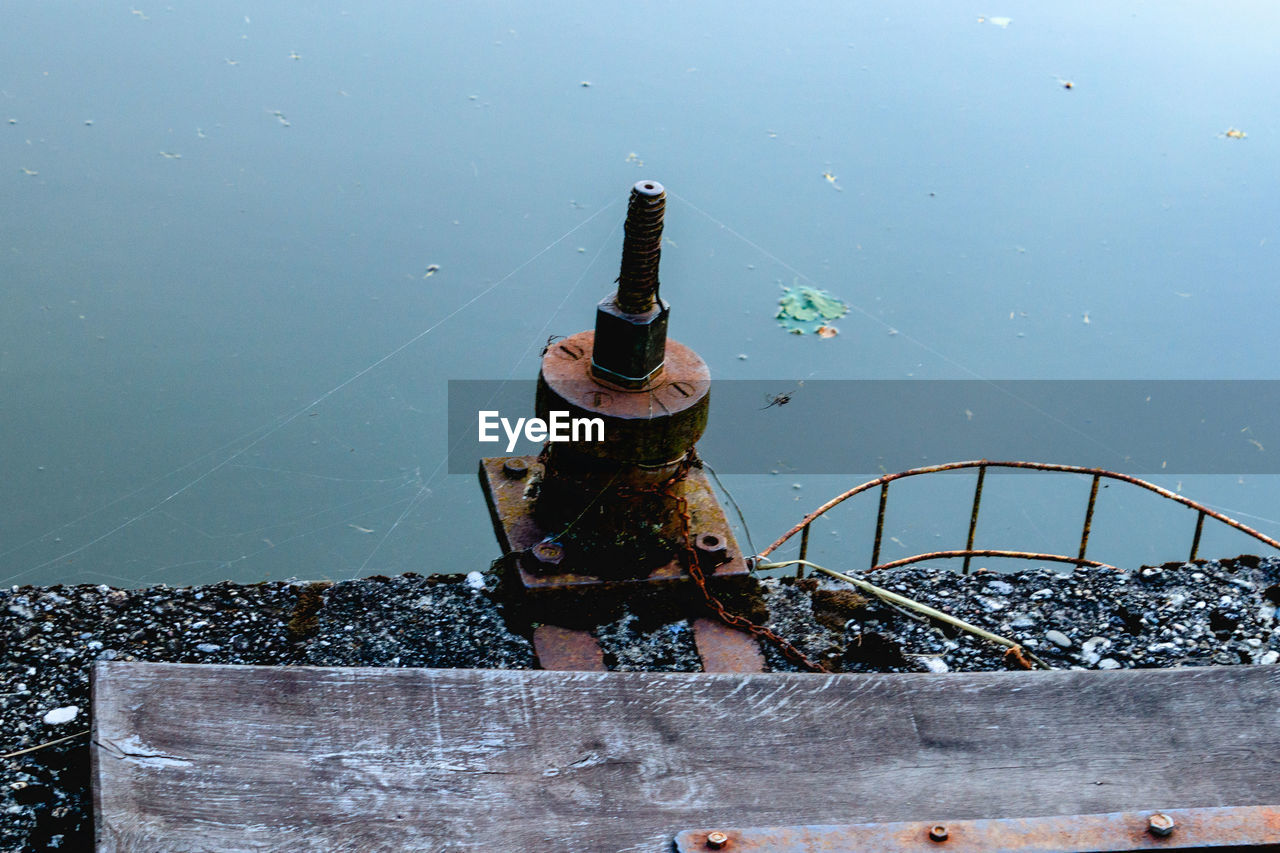 water, day, nature, metal, no people, high angle view, outdoors, bottle, railing, sky, rusty, container, cigarette, built structure, architecture, sunlight, focus on foreground, food and drink, refreshment