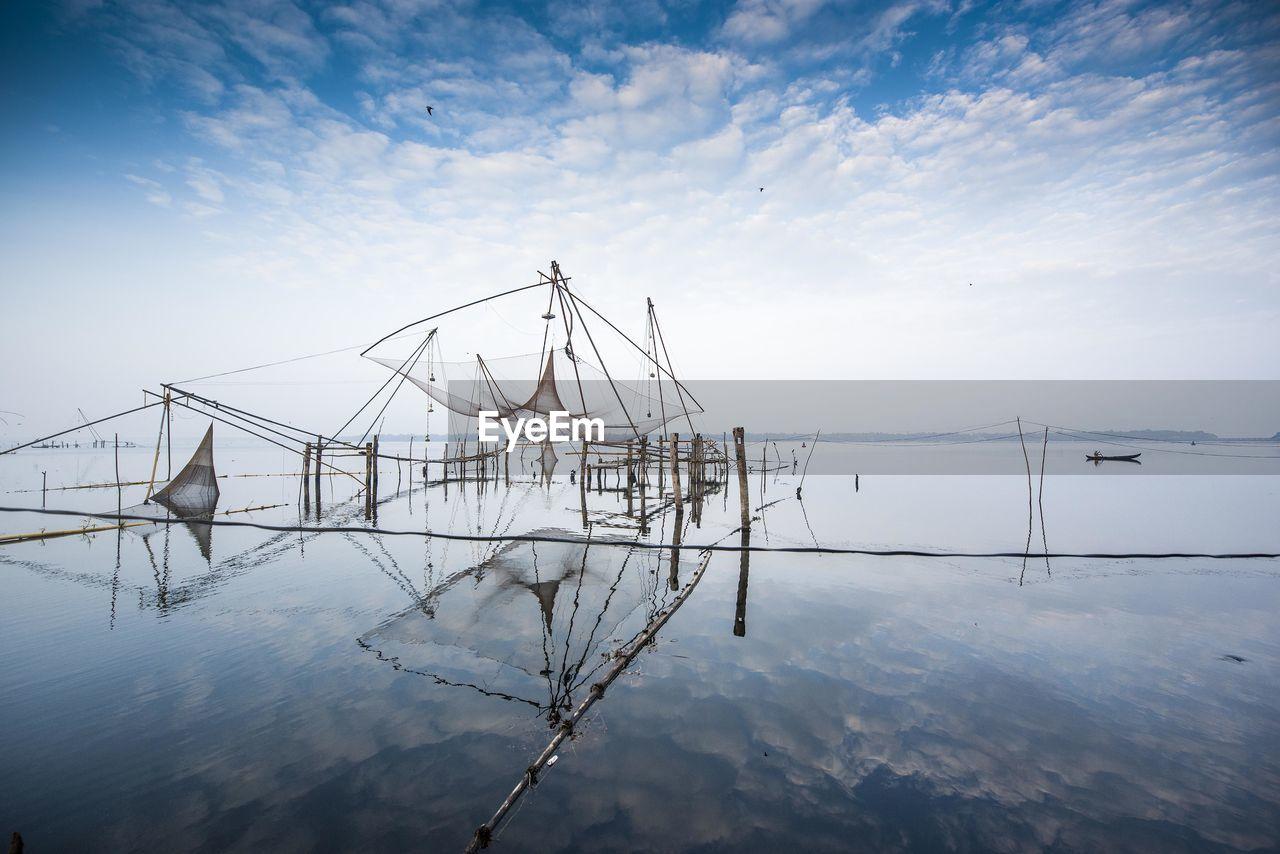 View Of Fishing Net In Lake