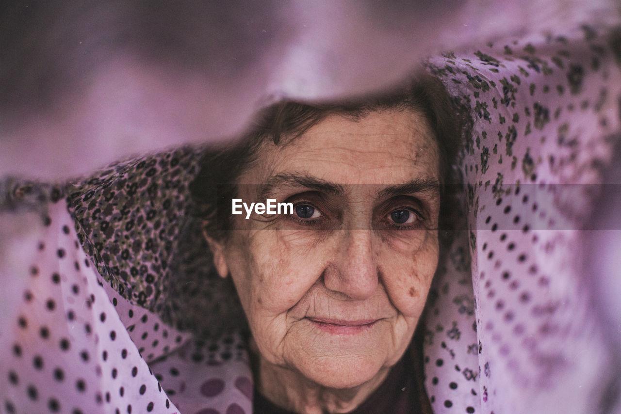 Portrait Of Senior Woman Wearing Scarf