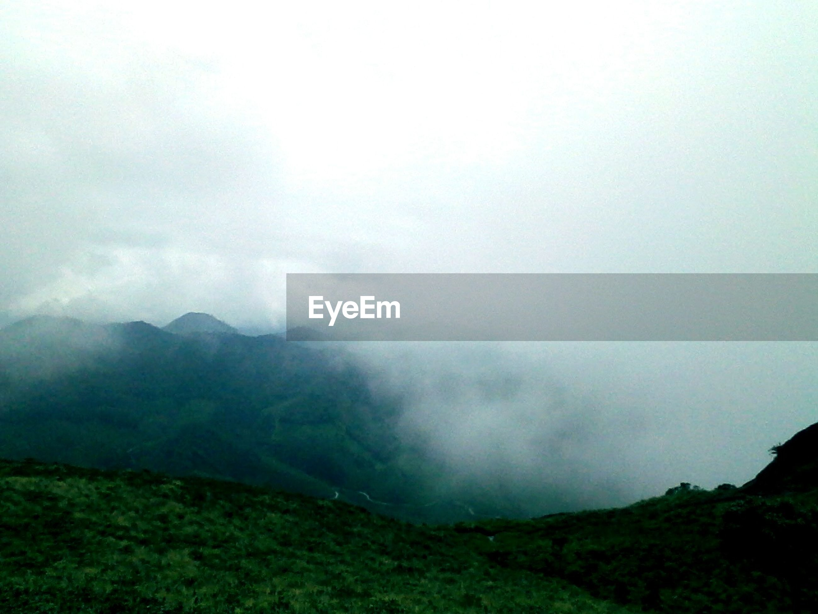 tranquil scene, mountain, scenics, landscape, tranquility, non-urban scene, beauty in nature, nature, fog, remote, sky, idyllic, countryside, green color, solitude, mountain range, tourism, travel destinations, cloud - sky, day, majestic, foggy, outdoors, lush foliage, vacations, atmosphere, dreamlike, physical geography