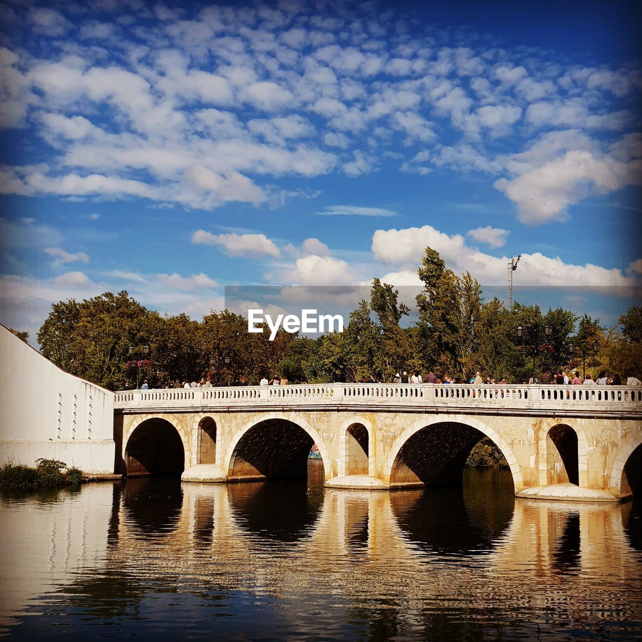 bridge, connection, water, architecture, cloud - sky, bridge - man made structure, built structure, sky, arch, nature, tree, reflection, waterfront, river, plant, arch bridge, transportation, no people, day, outdoors, arched