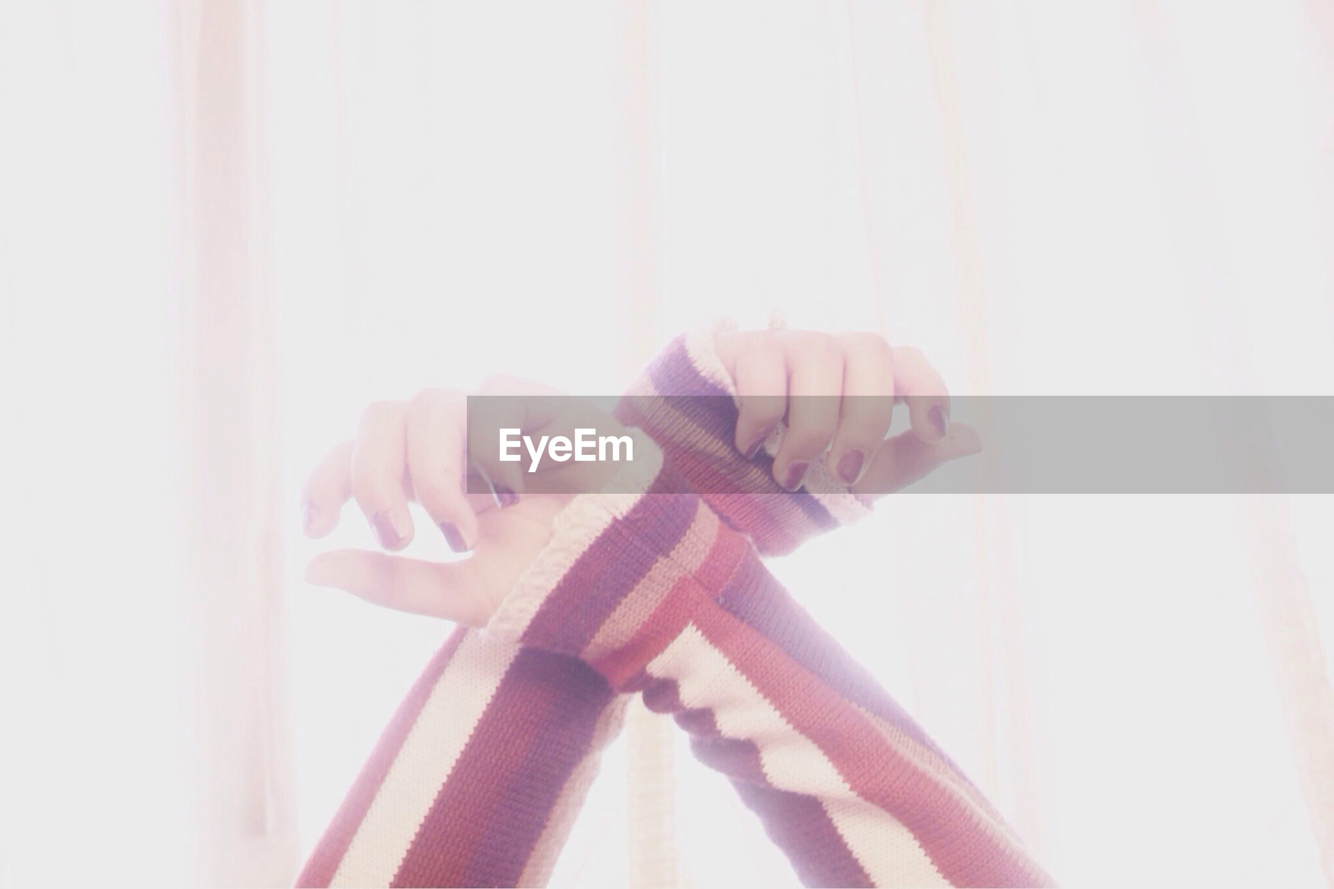 indoors, person, part of, home interior, cropped, close-up, wall - building feature, curtain, copy space, sunlight, human finger, lifestyles, holding, auto post production filter, day, side view