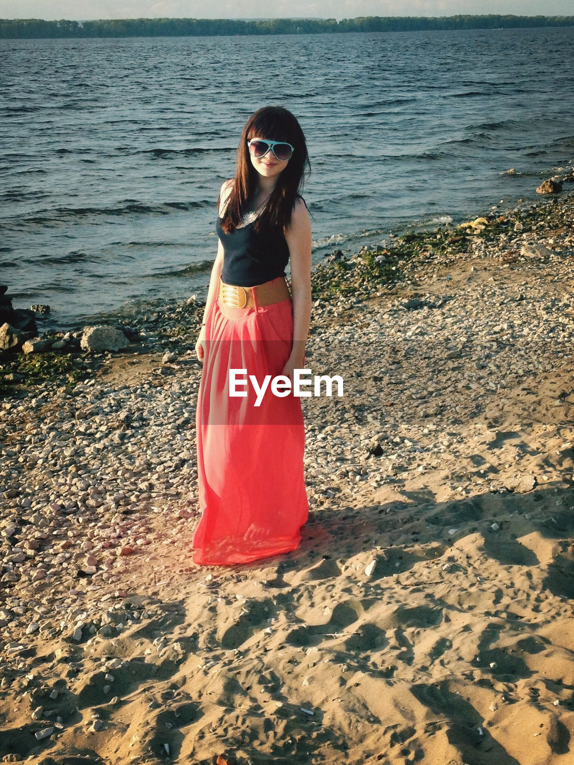 beach, lifestyles, full length, young adult, leisure activity, sea, casual clothing, shore, water, sand, vacations, person, standing, young women, relaxation, tranquility, nature, three quarter length