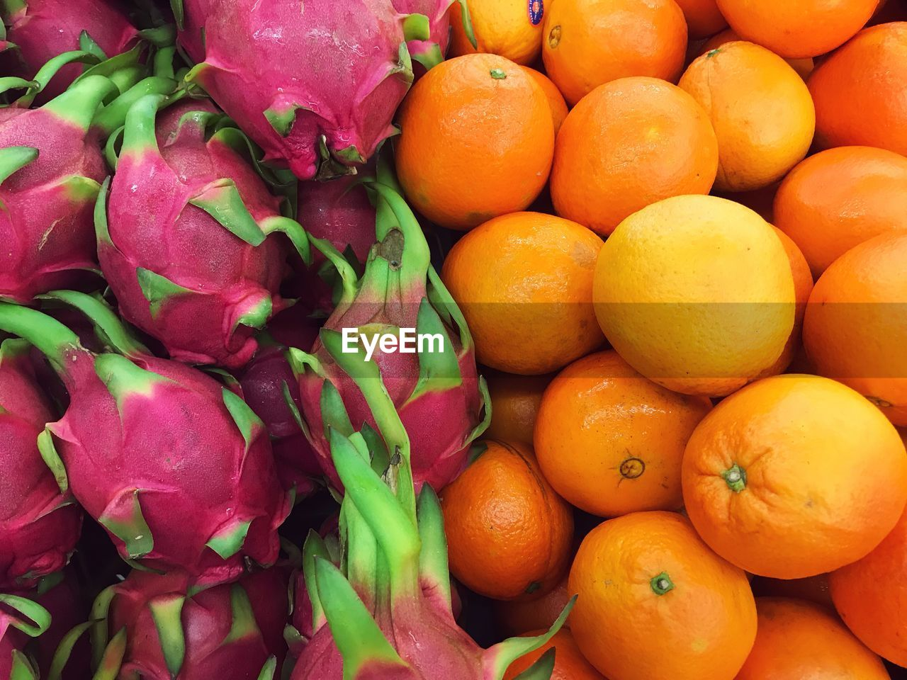 food, healthy eating, food and drink, wellbeing, freshness, market, for sale, backgrounds, full frame, retail, vegetable, market stall, choice, large group of objects, still life, orange color, fruit, no people, abundance, high angle view, organic, retail display, orange, sale, ripe