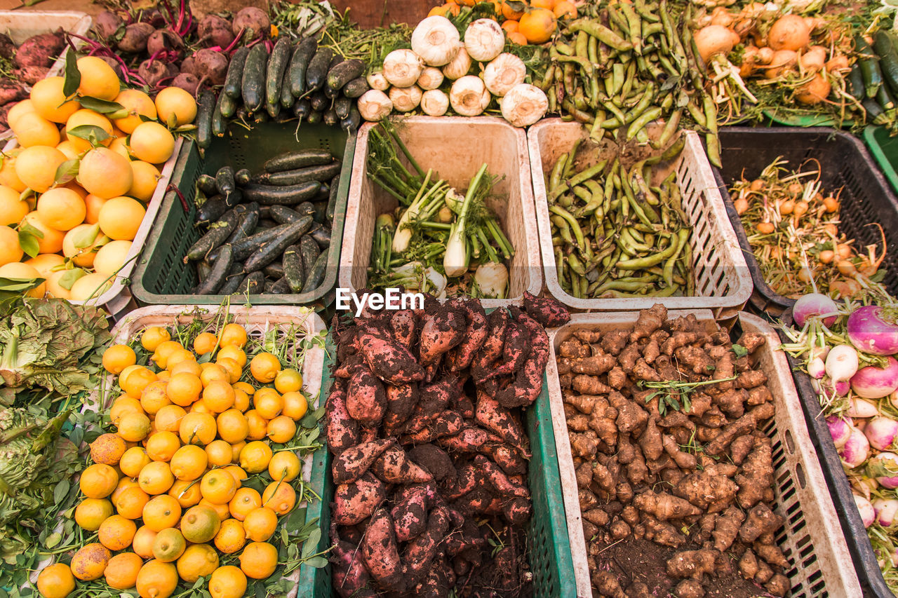 High angle view of vegetables and fruits for sale at market stall