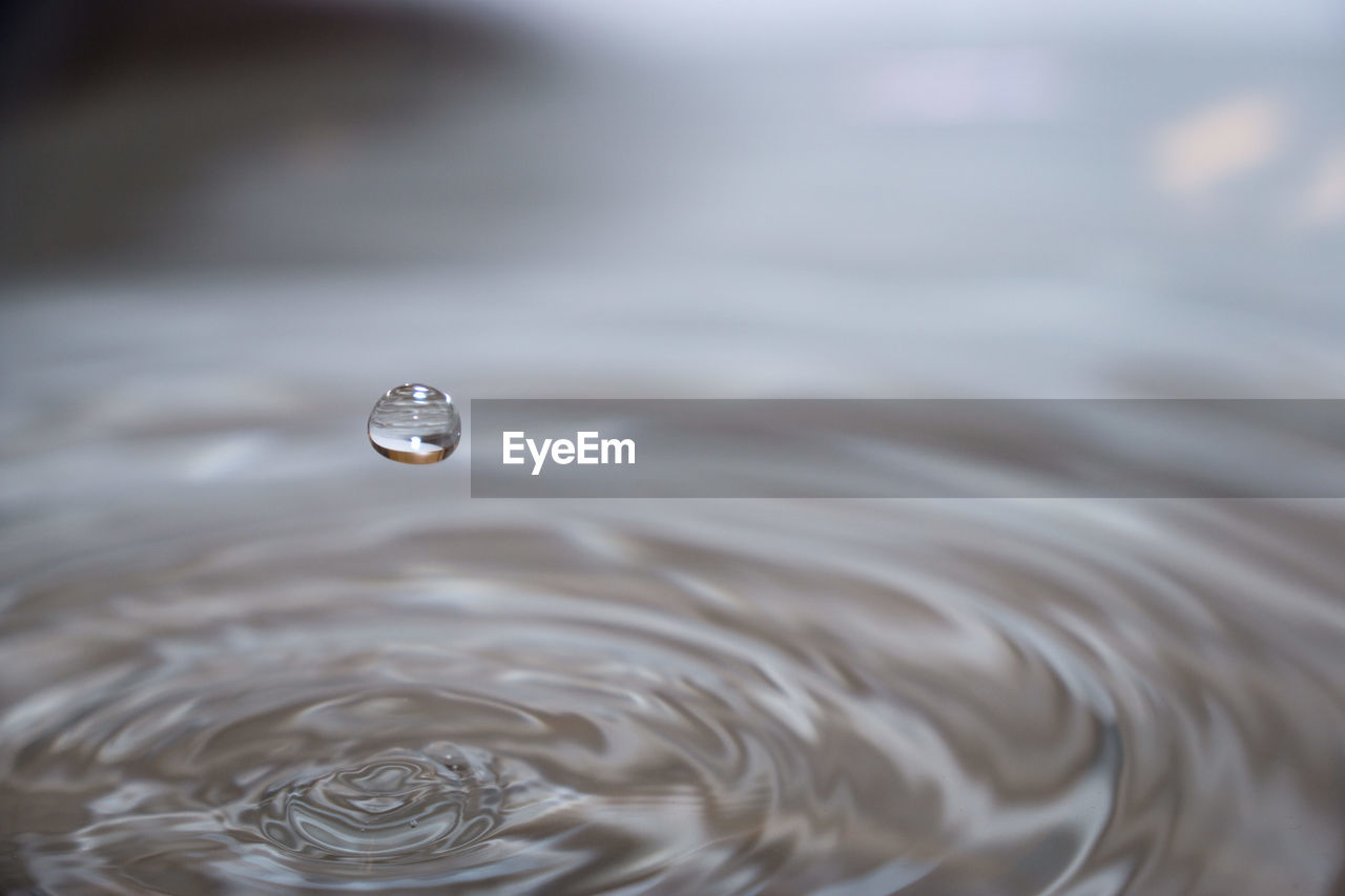 water, rippled, motion, close-up, drop, nature, no people, selective focus, day, purity, waterfront, outdoors, splashing, focus on foreground, wet, pattern, falling, freshness, beauty in nature, concentric, high-speed photography