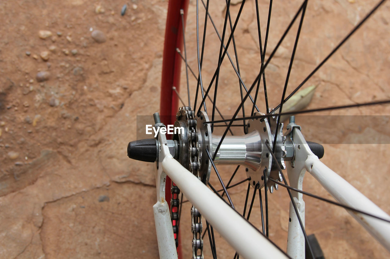 Close-Up Of Bicycle Wheel On Road