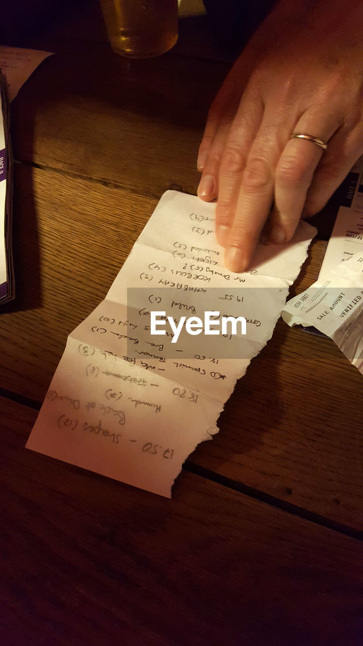 table, human hand, indoors, real people, one person, human body part, paper, text, book, writing, education, close-up, lifestyles, learning, day, people
