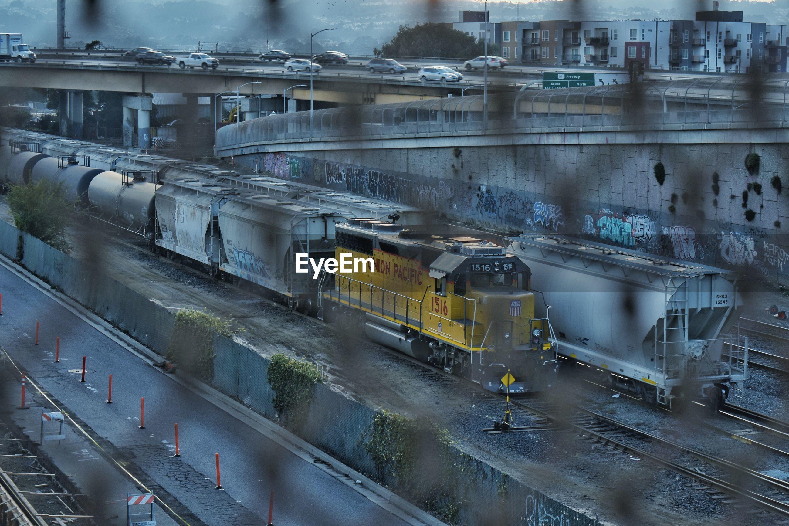 High angle view of train on railroad tracks seen through window