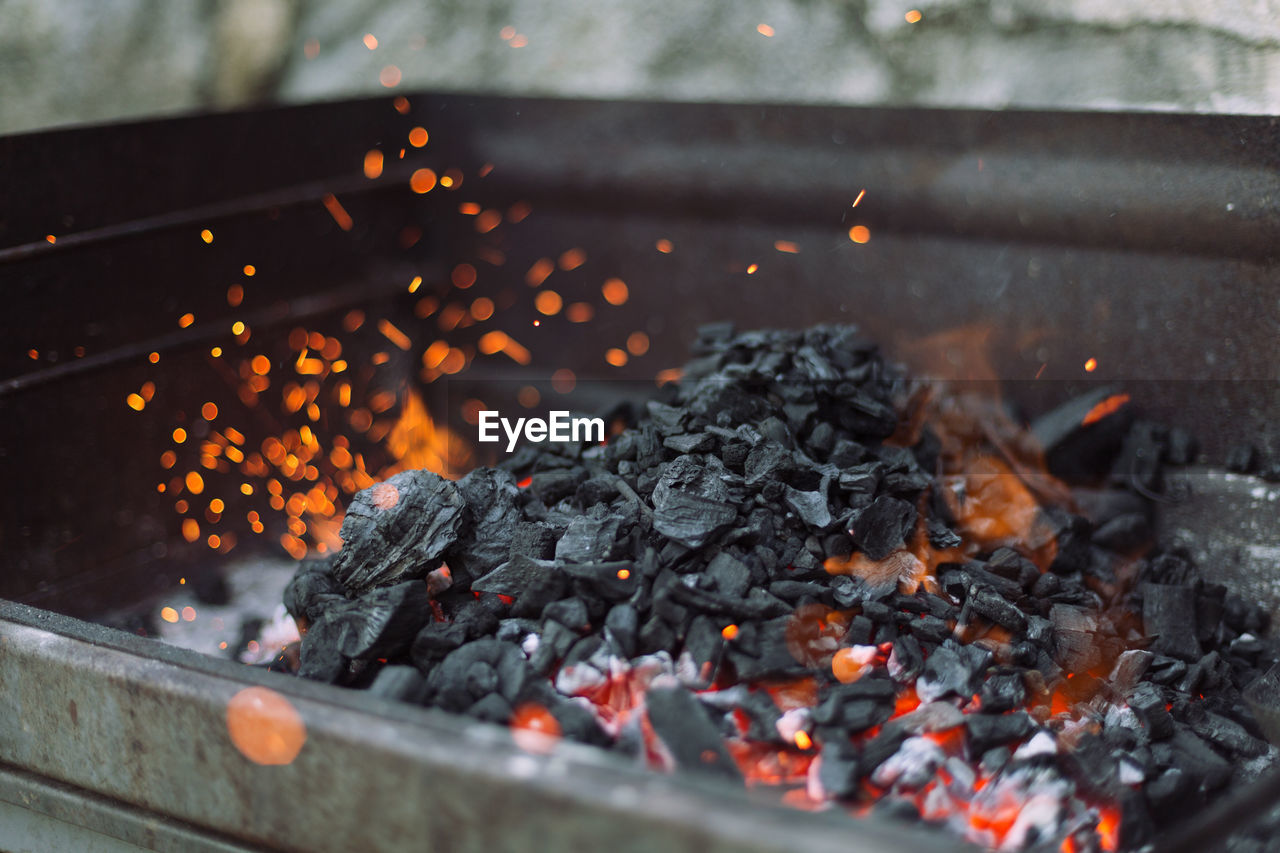 Close-Up Of Charcoal Burning In Barbecue Grill