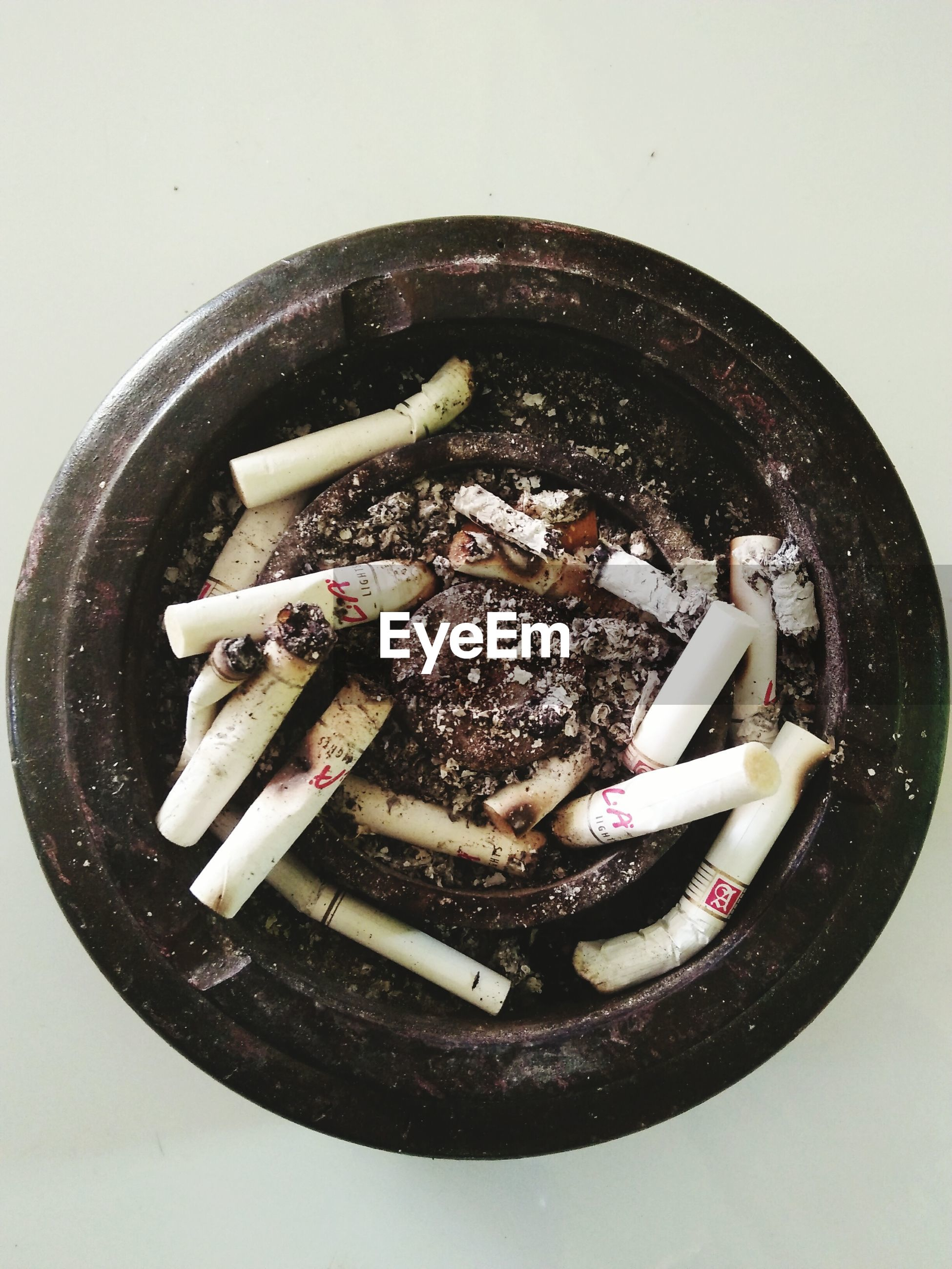 cigarette butt, smoking issues, bad habit, addiction, studio shot, directly above, white background, ashtray, no people, food and drink, close-up, food, ash, indoors, freshness