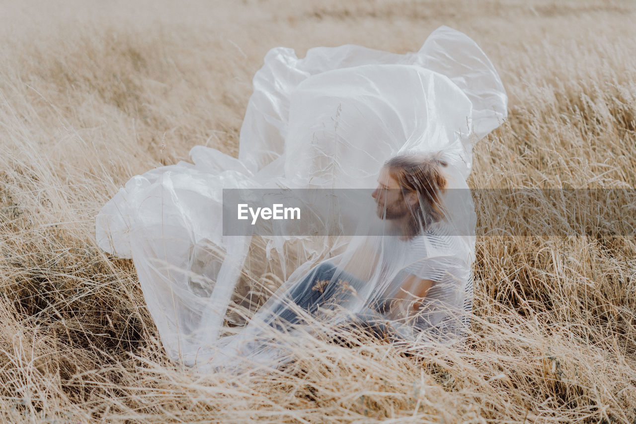 land, wedding, event, one person, bride, celebration, field, newlywed, life events, wedding dress, real people, lifestyles, women, plant, young women, young adult, fashion, adult, veil, outdoors, hairstyle