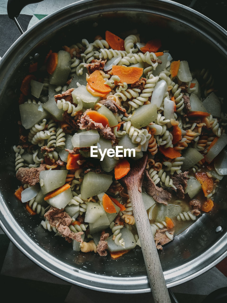 food and drink, food, indoors, kitchen utensil, vegetable, healthy eating, freshness, wellbeing, no people, still life, close-up, high angle view, directly above, spoon, household equipment, eating utensil, bowl, preparation, ready-to-eat, preparing food, vegetarian food, chopped