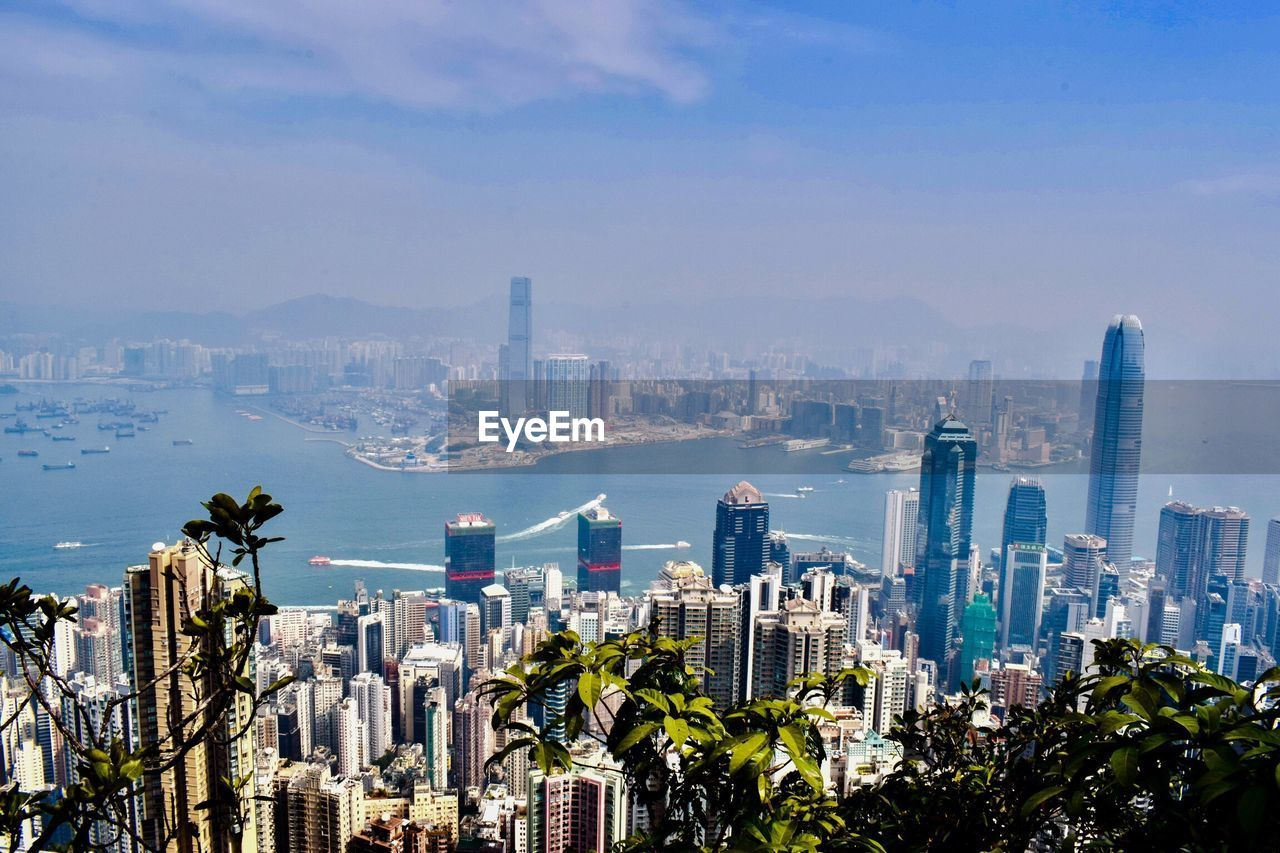 city, cityscape, building exterior, built structure, building, architecture, office building exterior, sky, skyscraper, tall - high, residential district, office, modern, nature, urban skyline, water, crowded, crowd, financial district, outdoors, bay, spire