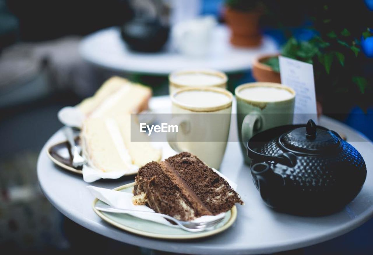 food and drink, plate, table, food, freshness, indoors, ready-to-eat, serving size, close-up, cup, no people, still life, cake, focus on foreground, slice, dessert, sweet, mug, crockery, drink, temptation, breakfast