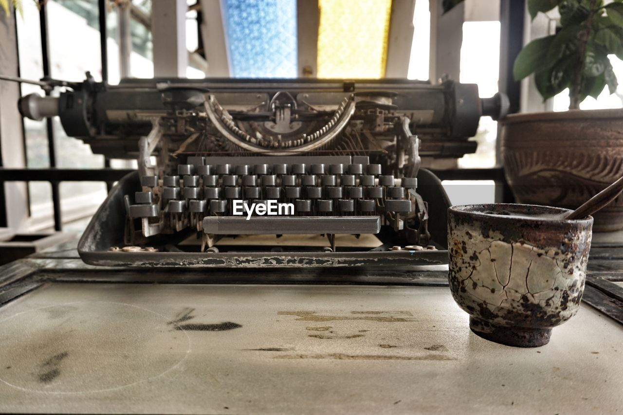 old-fashioned, typewriter, antique, history, retro styled, indoors, the past, machinery, no people, technology, museum, manufacturing equipment, day, close-up