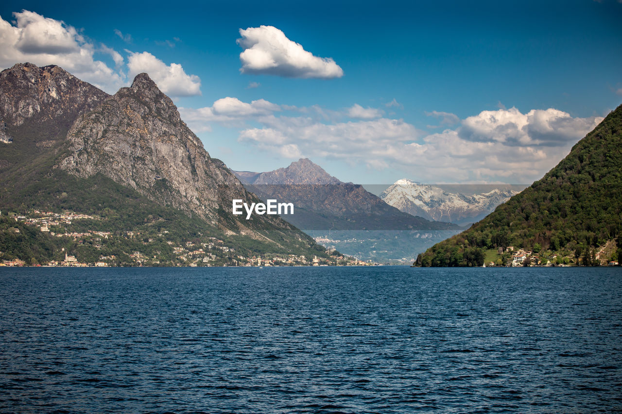 mountain, water, beauty in nature, scenics - nature, sky, waterfront, tranquil scene, cloud - sky, tranquility, mountain range, non-urban scene, nature, no people, day, lake, idyllic, remote, outdoors, mountain peak, range