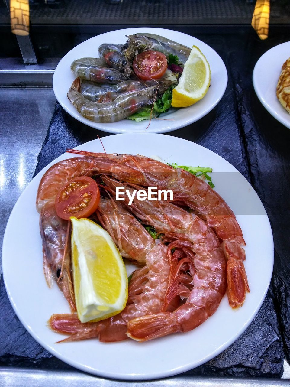 food and drink, food, plate, seafood, lemon, freshness, table, serving size, healthy eating, citrus fruit, meat, ready-to-eat, slice, lime, indoors, no people, salmon, close-up, shrimp, day, sashimi