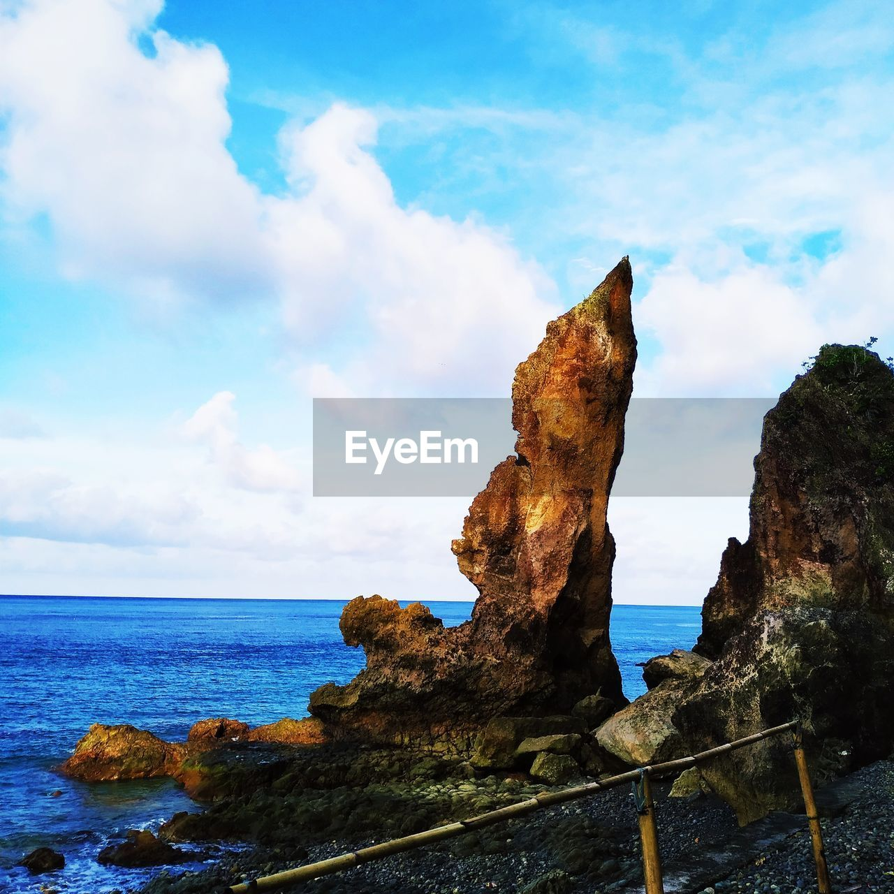 sky, sea, cloud - sky, water, beauty in nature, scenics - nature, nature, horizon over water, tranquility, tranquil scene, no people, horizon, rock, land, rock - object, day, solid, non-urban scene, beach, outdoors, eroded