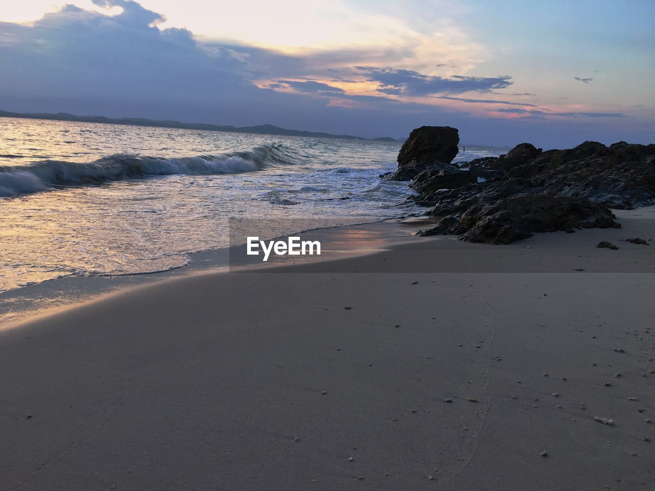 sea, water, beach, land, sky, beauty in nature, scenics - nature, sunset, sand, rock, tranquility, rock - object, horizon over water, motion, solid, horizon, nature, cloud - sky, tranquil scene, no people, outdoors