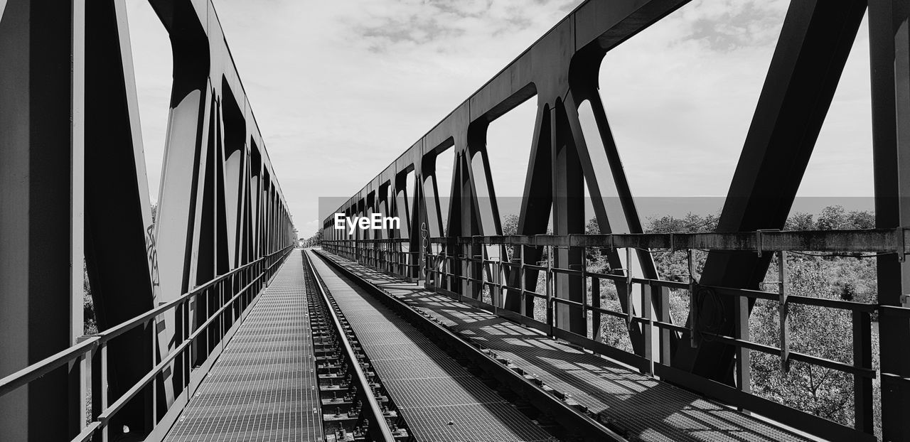 bridge, transportation, connection, built structure, bridge - man made structure, architecture, sky, cloud - sky, nature, railing, engineering, day, diminishing perspective, the way forward, direction, rail transportation, metal, railway bridge, outdoors, track, long