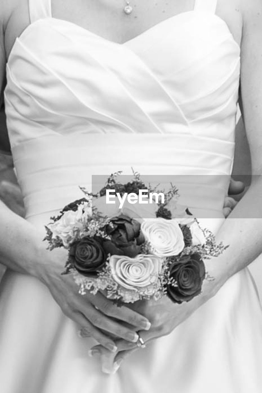 midsection, flower, adult, celebration, holding, plant, one person, rose, wedding, women, wedding dress, rose - flower, hand, clothing, bouquet, bride, newlywed, flowering plant, flower arrangement, couple - relationship