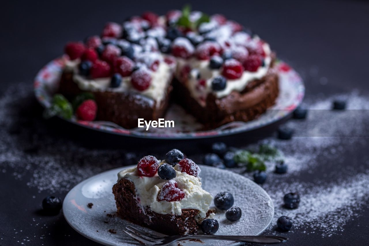 Close-Up Of Cake In Plates On Table