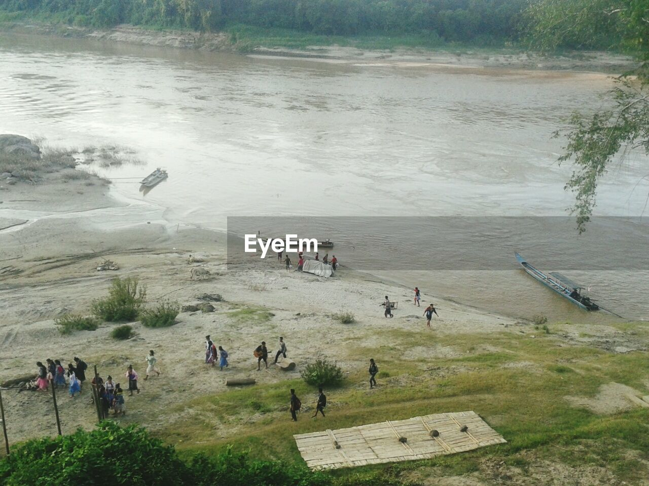 High Angle View Of People At Riverbank