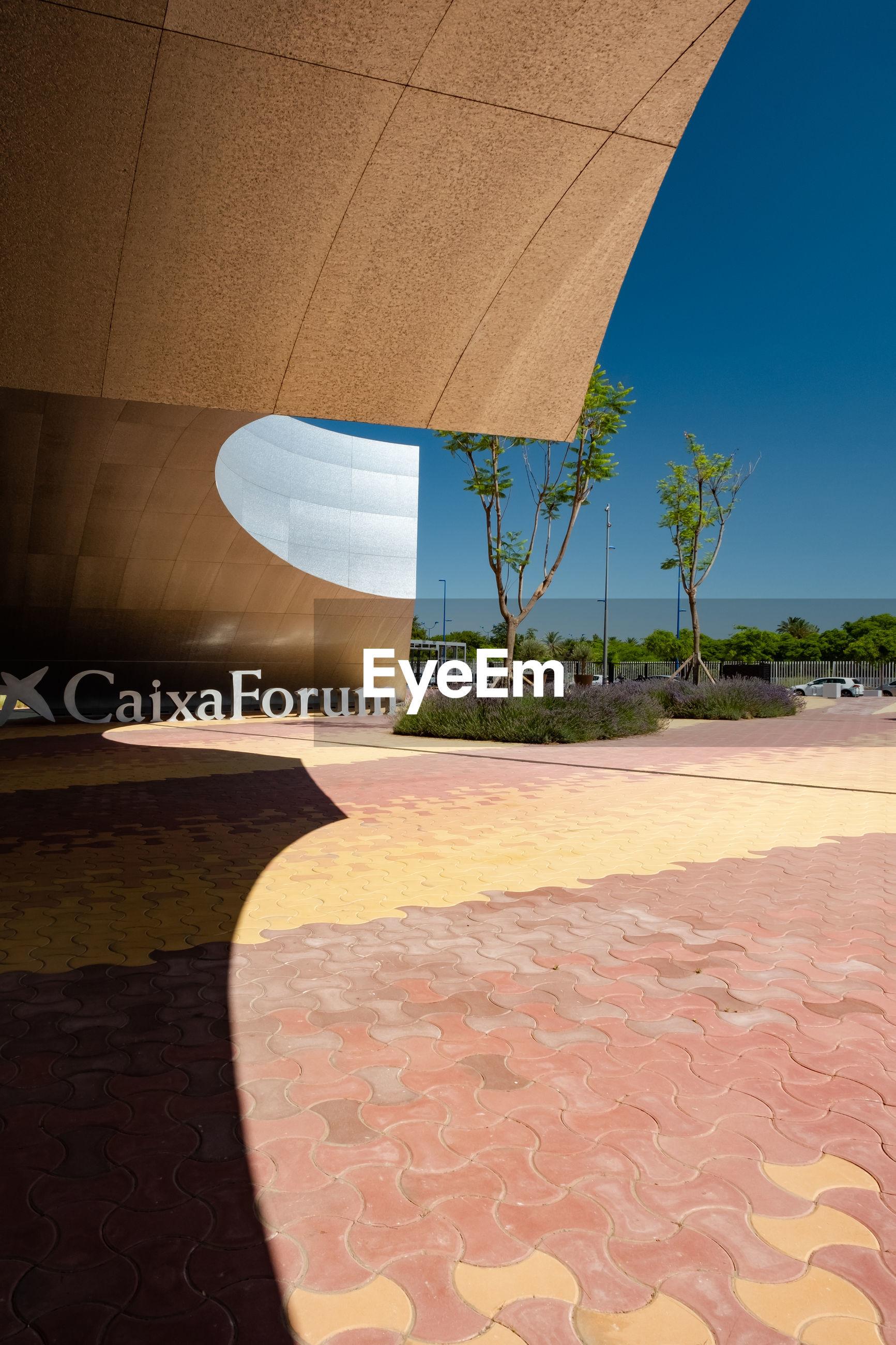 VIEW OF FOOTPATH AGAINST BUILDINGS