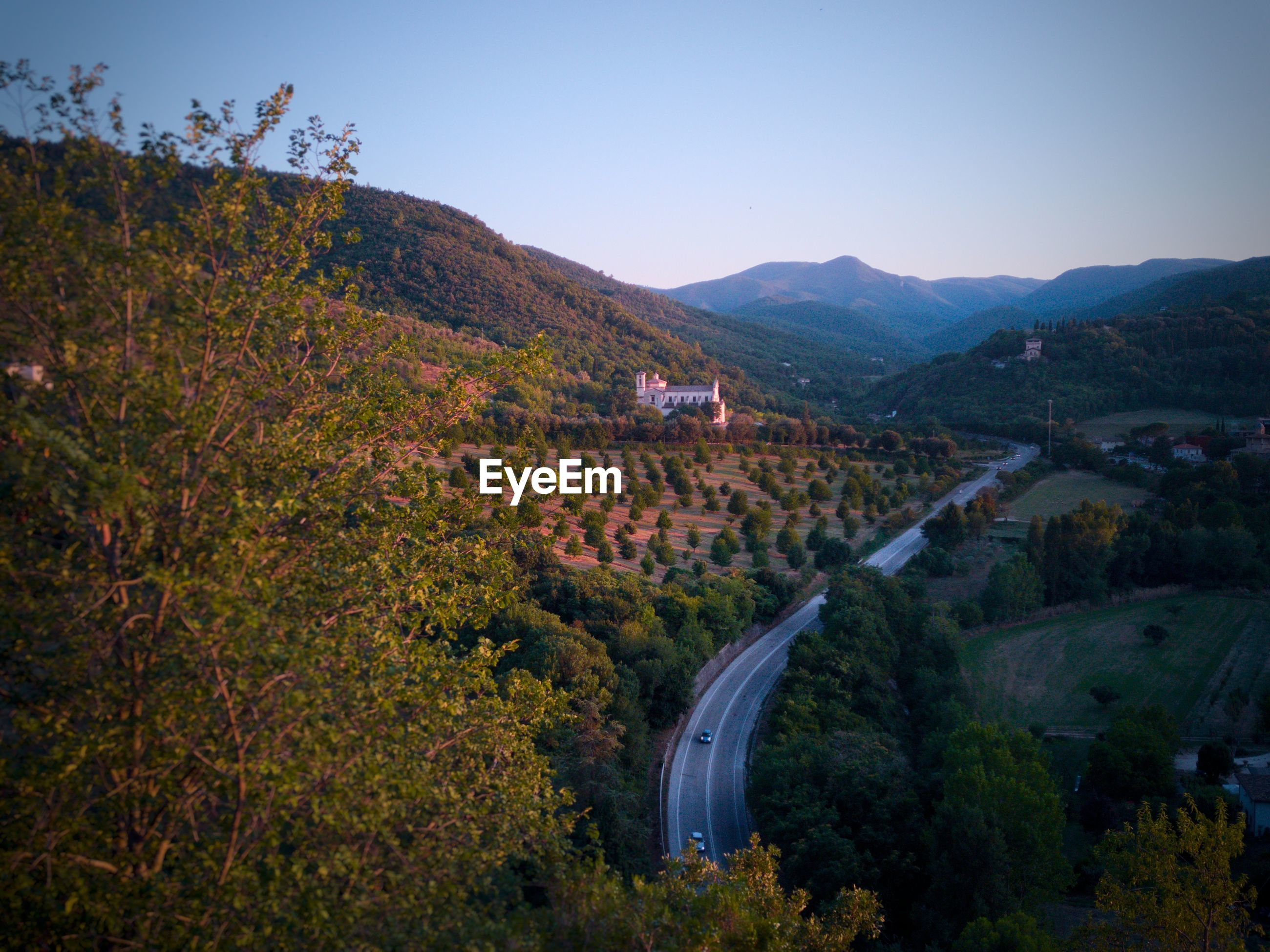 Scenic view of mountains against clear sky during autumn