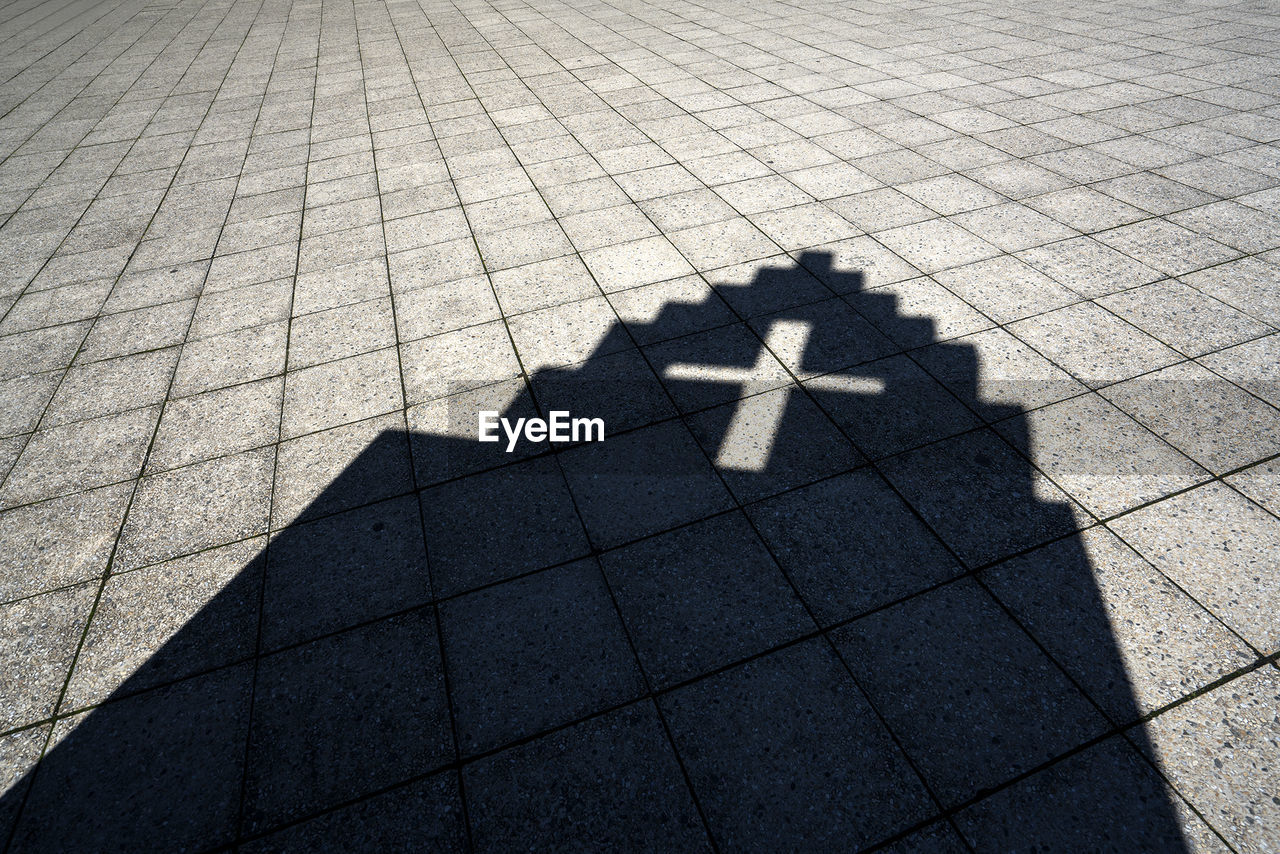 Shadow Of A Church On The Ground