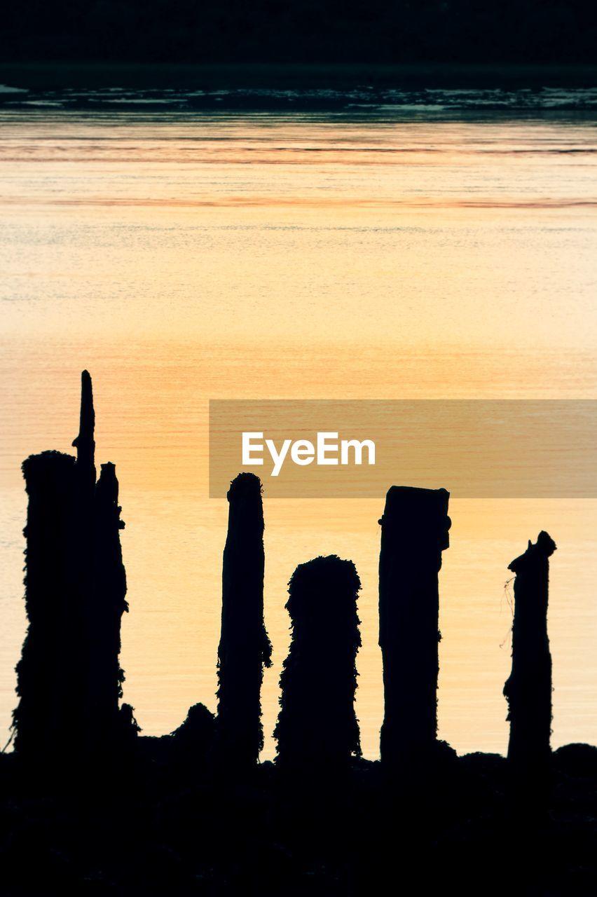 sunset, sky, silhouette, orange color, scenics - nature, beauty in nature, nature, tranquil scene, tranquility, no people, water, land, outdoors, idyllic, sea, horizon, beach, non-urban scene, sunlight