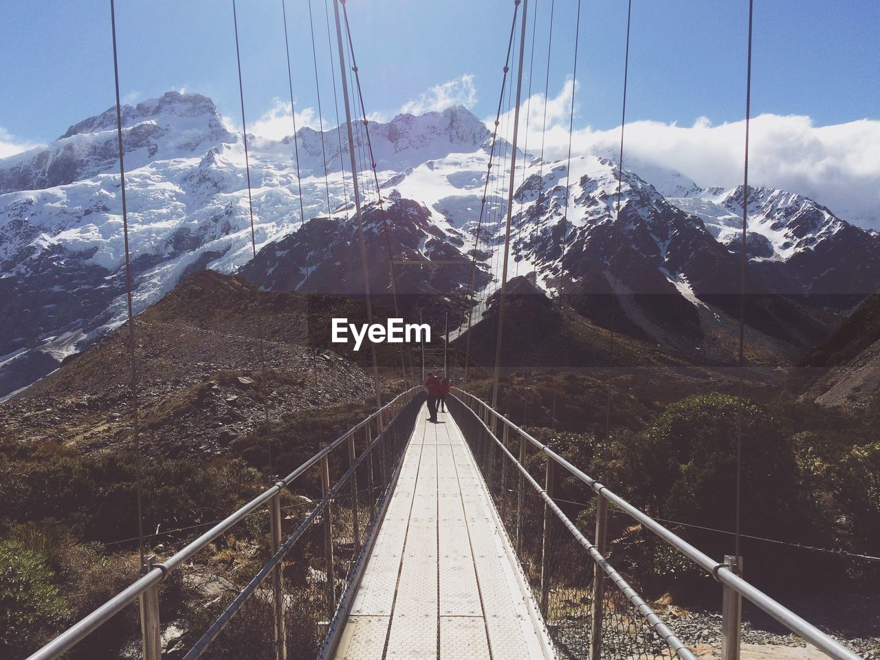 mountain, transportation, nature, connection, architecture, the way forward, built structure, direction, sky, day, bridge, railing, diminishing perspective, scenics - nature, winter, mountain range, snow, bridge - man made structure, cable, footbridge, no people, outdoors, snowcapped mountain