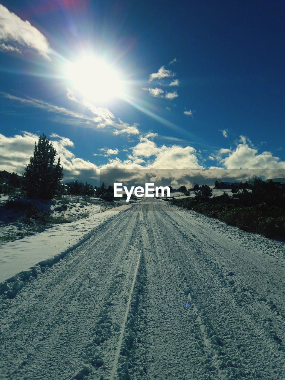 sunlight, sun, lens flare, sunbeam, sky, nature, snow, day, landscape, beauty in nature, outdoors, scenics, winter, road, no people, tire track, cold temperature