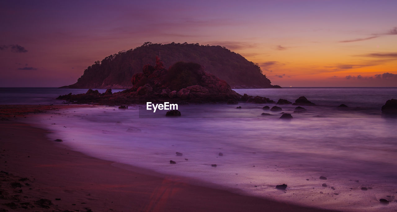 sunset, sea, beach, nature, beauty in nature, shore, sky, scenics, tranquil scene, tranquility, sand, water, horizon over water, rock - object, outdoors, no people